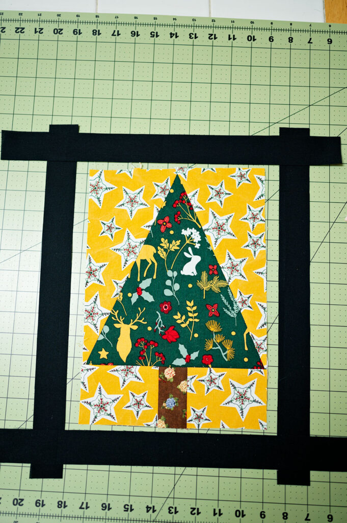 "overhead view showing the 1.5"" border pieces around the completed tree block"