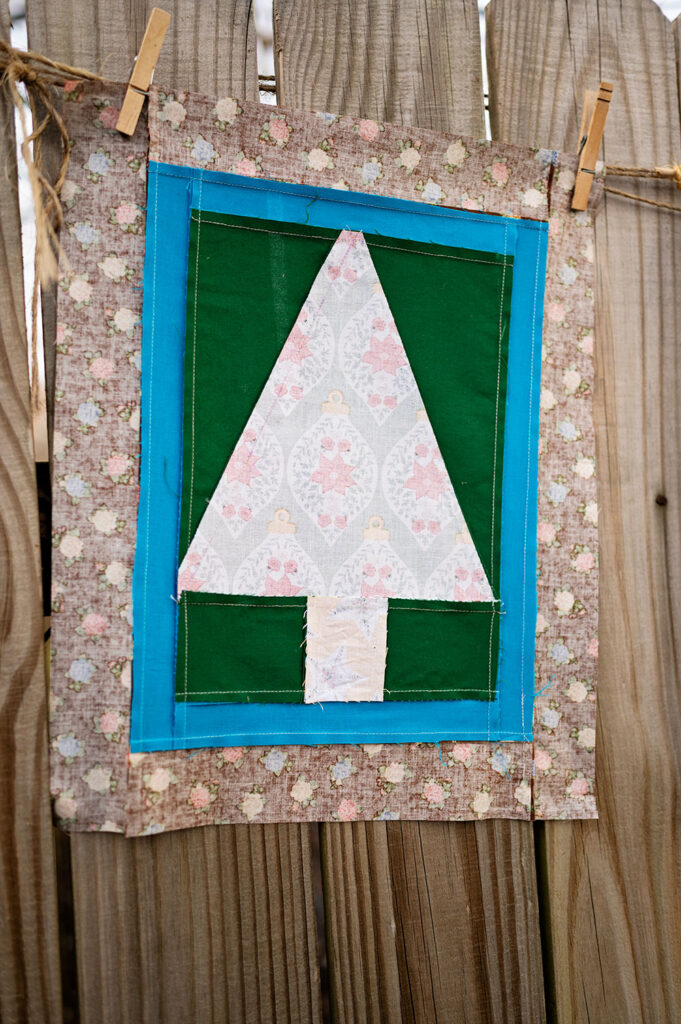 wrong side view of the Christmas tree quilt block showing the direction of the seams