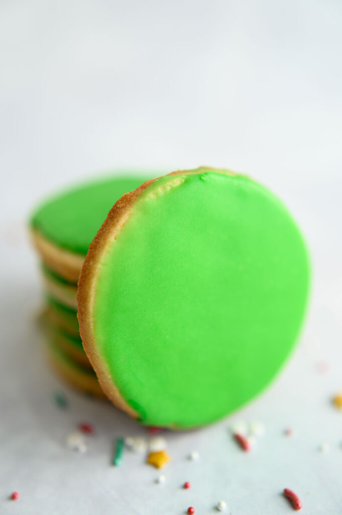 round sugar cookies with soft green glaze