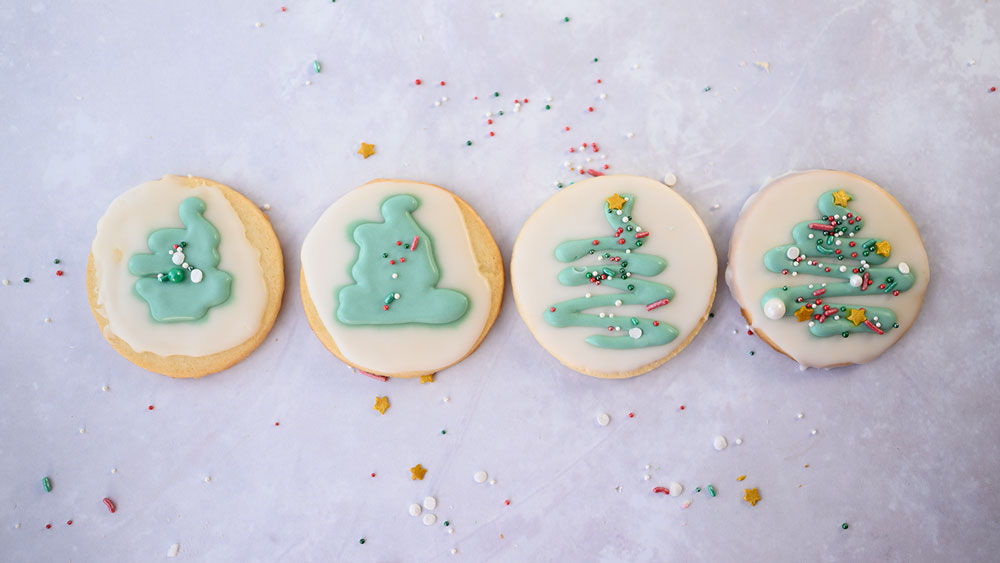 4 cookies lined up showing stages of getting green icing right for decorations