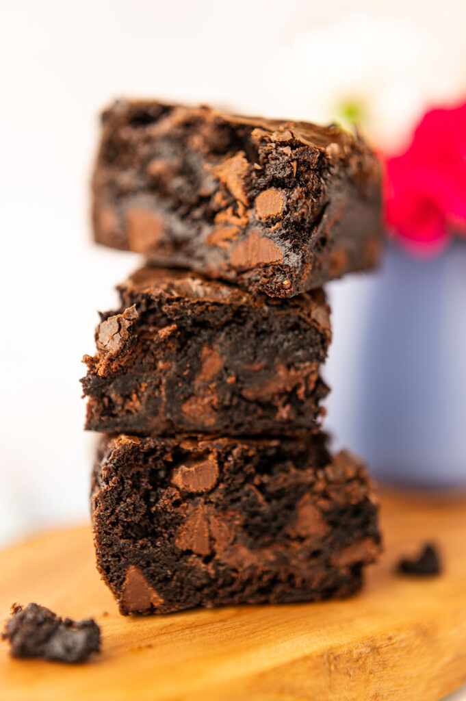 a closeup of a tall stack of thick, chocolate brownies