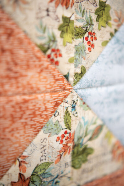 closeup of 8 point intersection in a pieced quilt block
