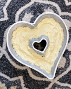 cake batter as seen over head in a heart shaped pan and ready for baking