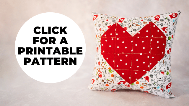 quilted heart pillow with a red heart and a bubble that says to click on it for a printable pattern