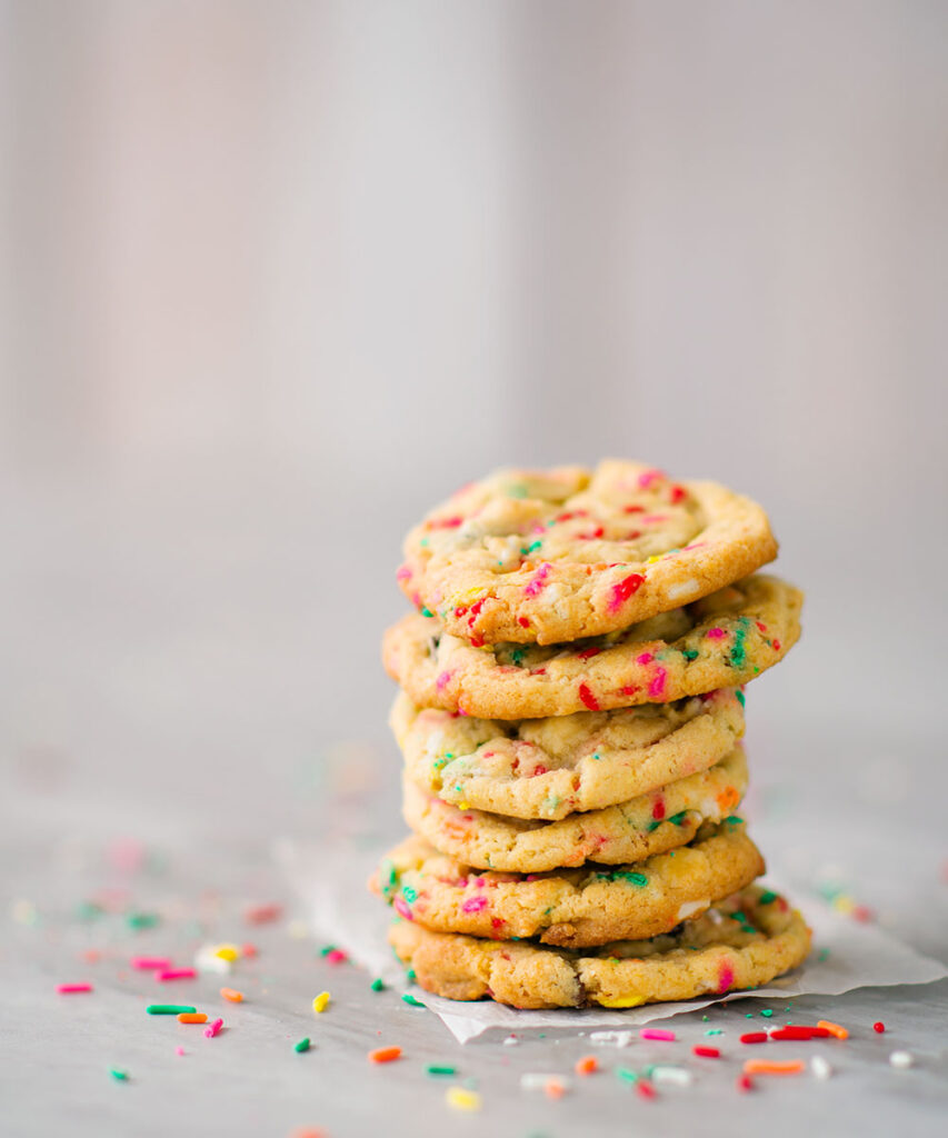 Tall cookie stack with lots of colorful rainbow sprinkles