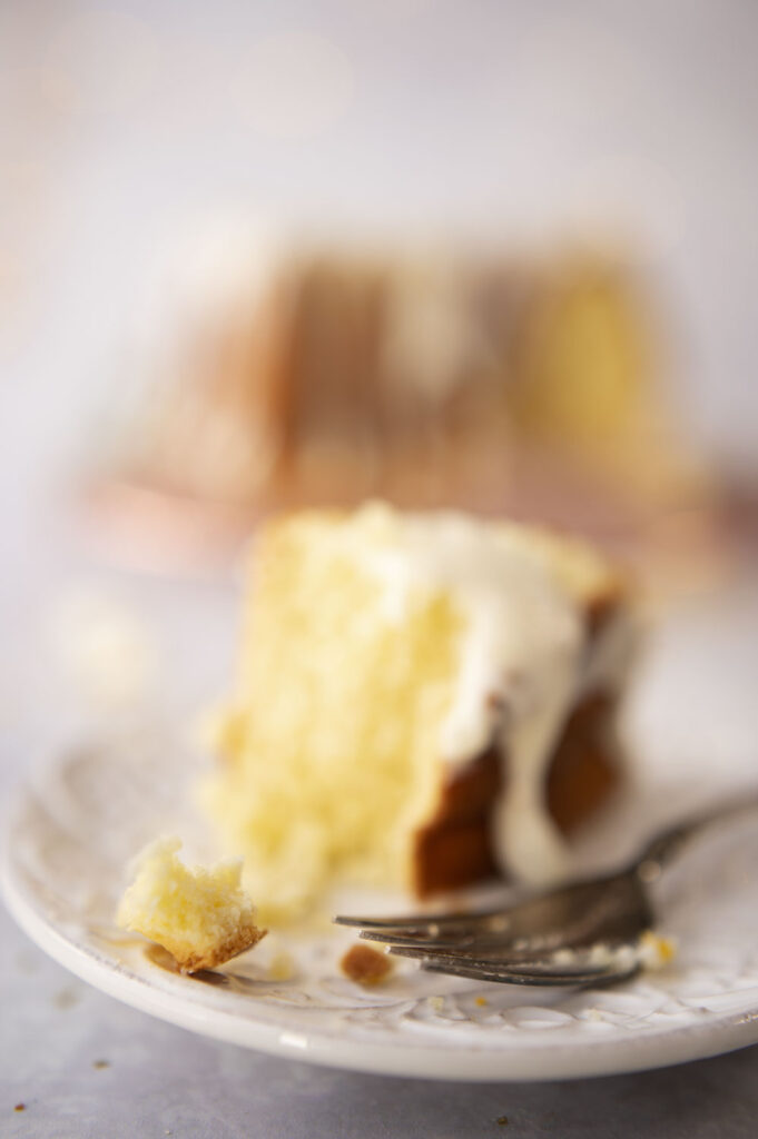 closeup up view of a slice of cake on a plate showing a crumb