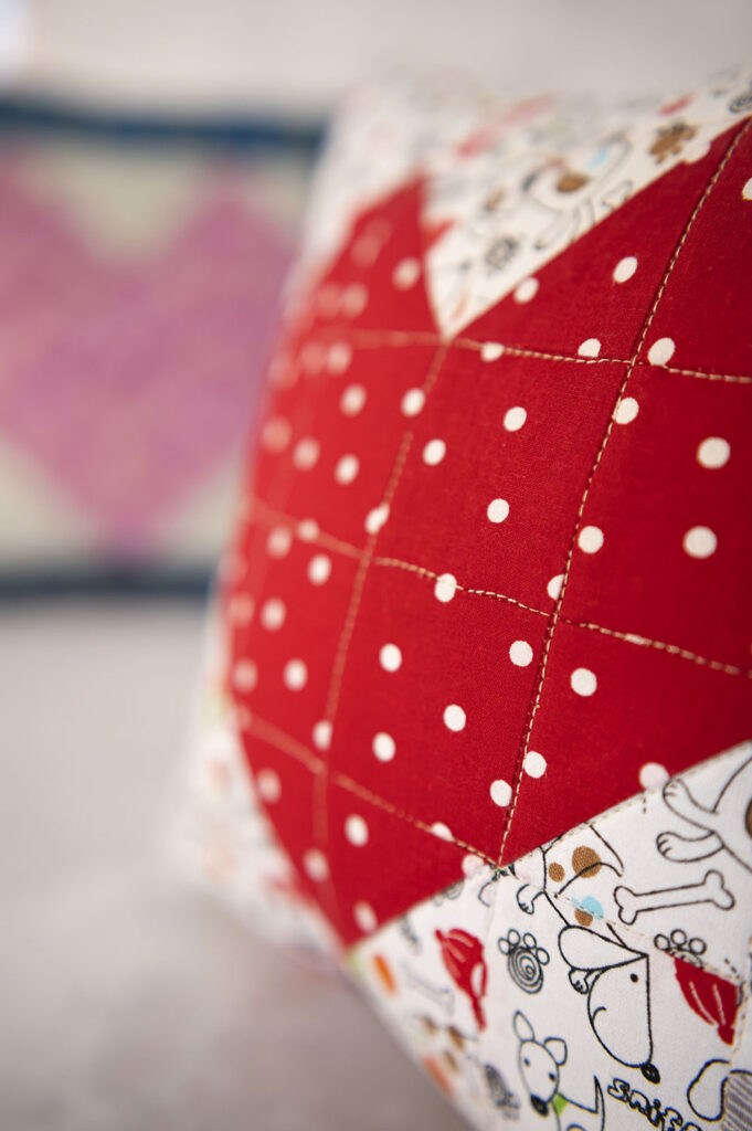 closeup of stitching in a quilted heart block