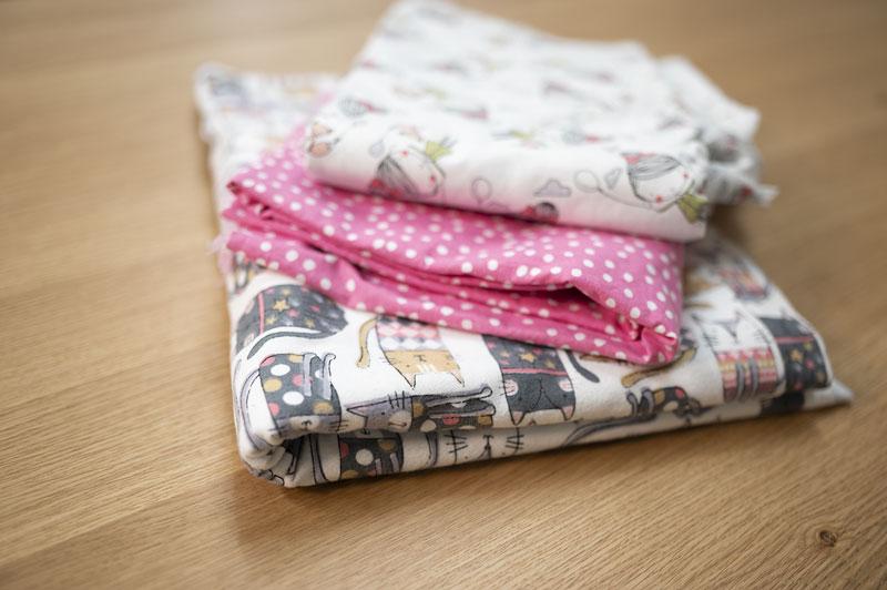 a sloppy pile of fabrics