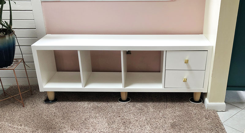 a kallax unit with feet attached with one drawer insert installed