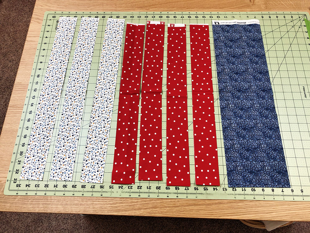 red, white and blue fabrics cut into strips