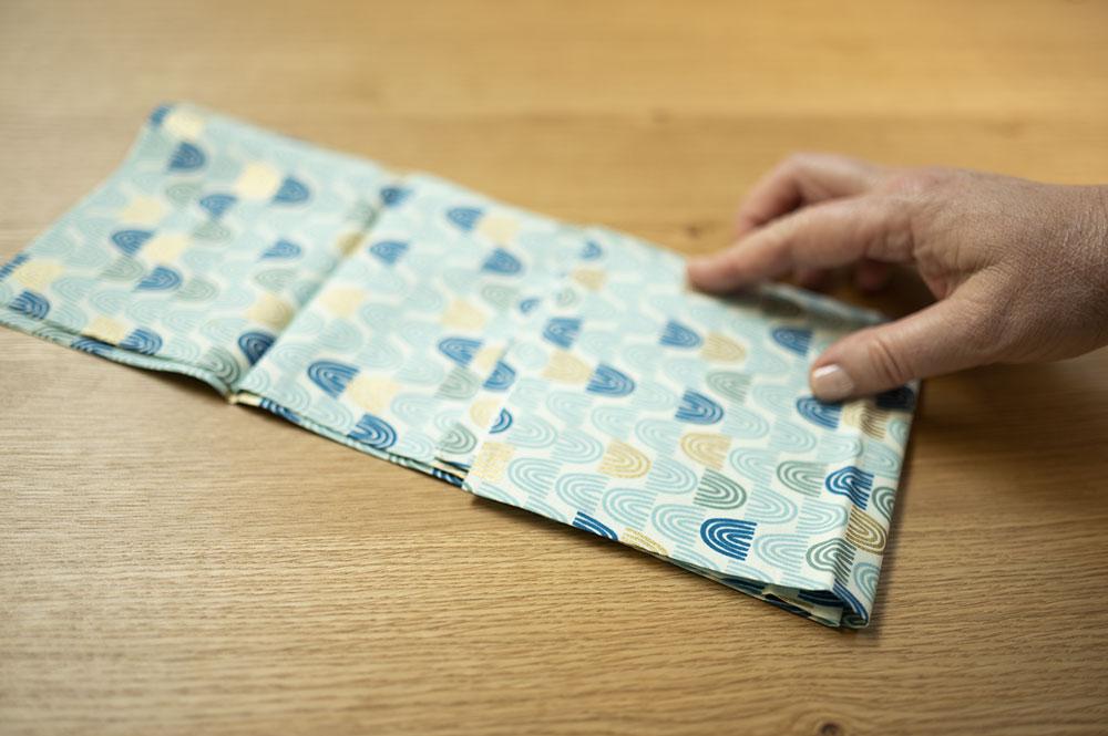 a hand folds fabric