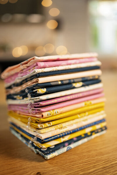 A tall stack of beautifully wrapped fat quarters