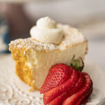 slice of angel food cake served with sliced strawberries and whipped cream