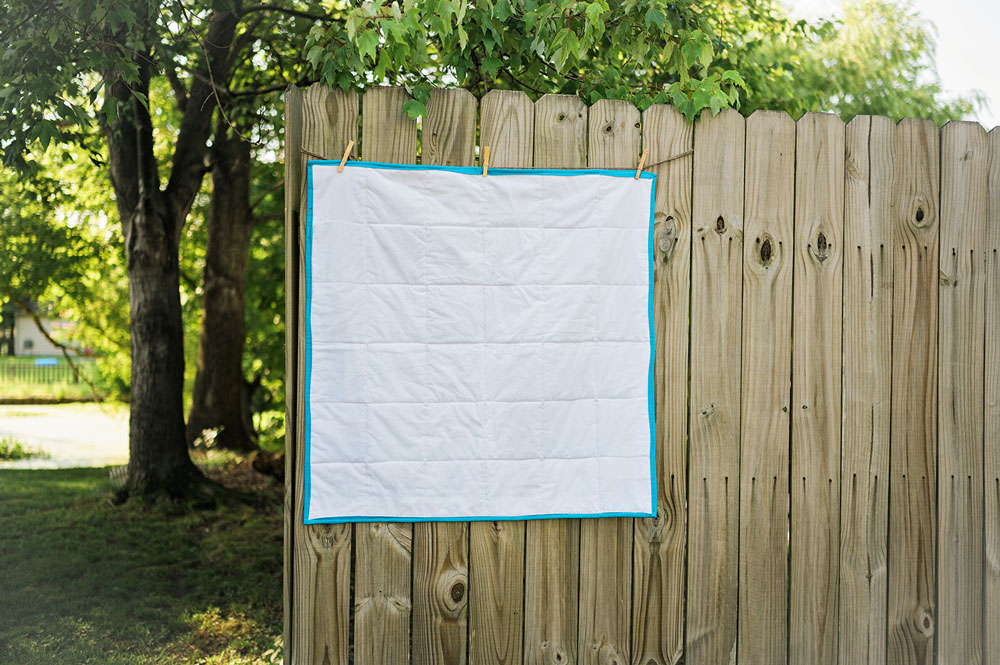 The back side of a baby quilt showing the quilt stitching