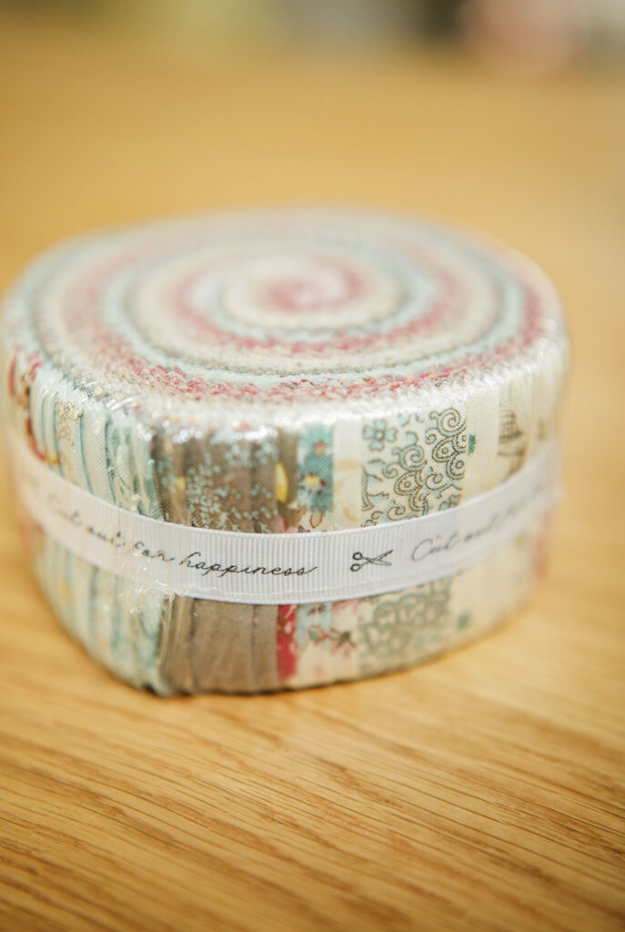 a jelly roll fabric package in pastle colors