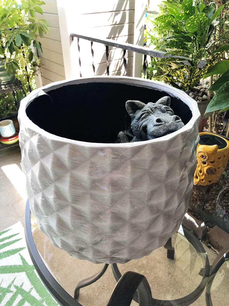a white planter for a large houseplant