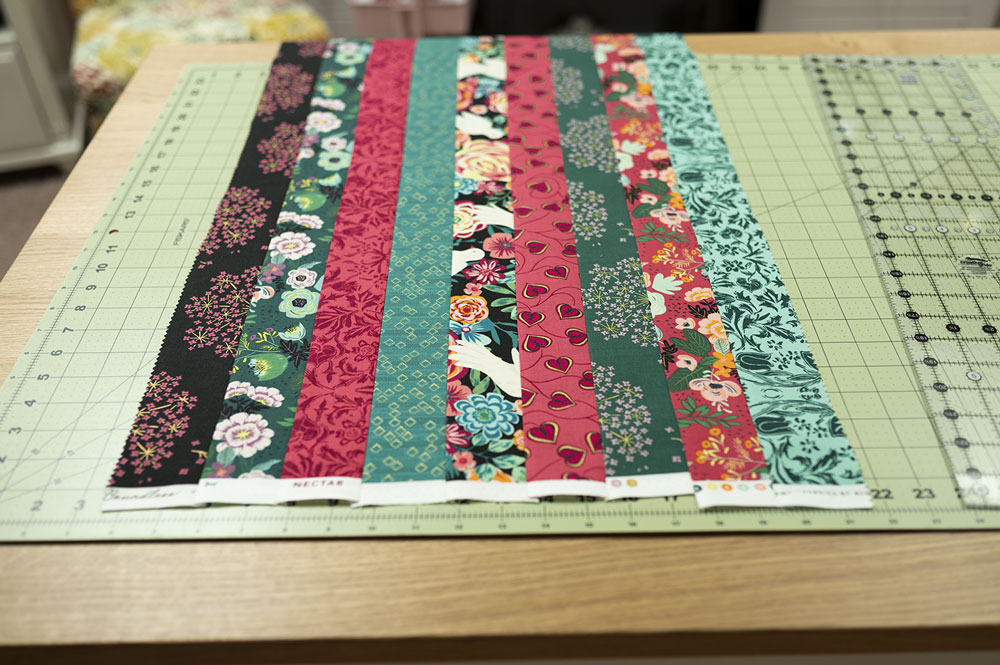 9 jelly roll strips pieced into one large strip set