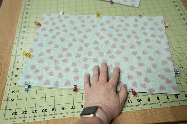 hand shows where to leave opening when sewing pieces together
