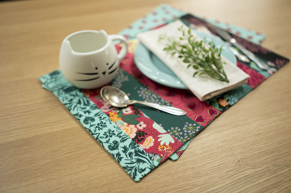 Place setting featuring colorful placemats